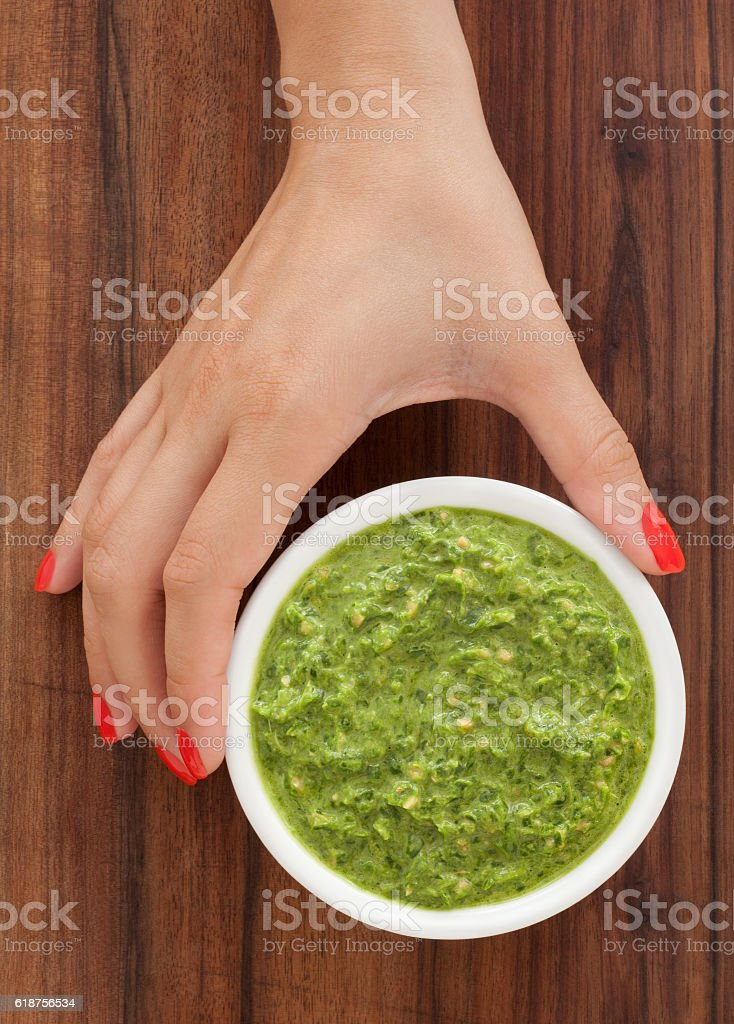 Offering pesto stock photo