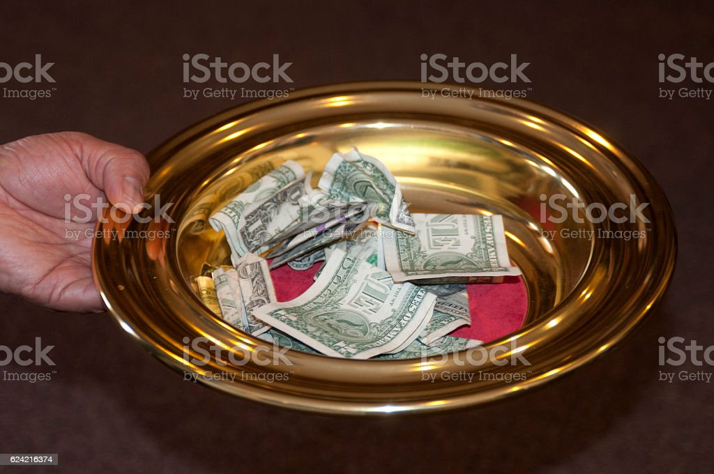 Offering Plate and tithe stock photo