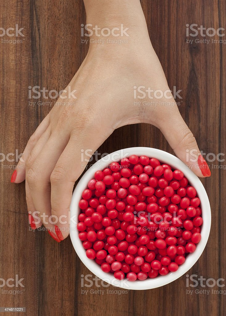 Offering red pills royalty-free stock photo