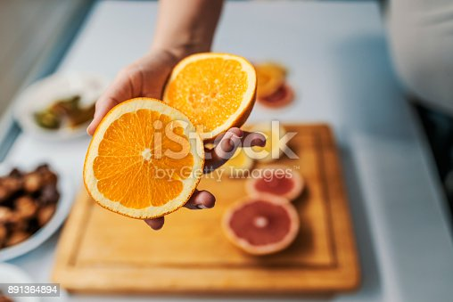 istock Offering you an orange 891364894