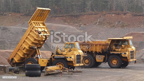 Wentworth, Canada - November 03, 2017: Caterpillar 769C Off-Highway trucks parked in gravel pit.