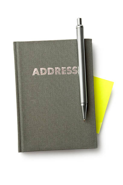 office: address book, pen and adhesive note - address book stock photos and pictures