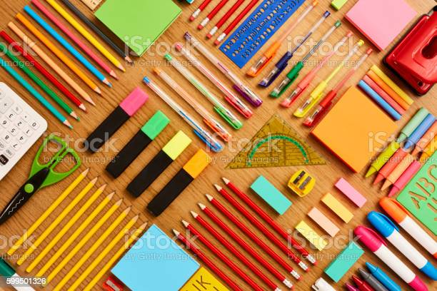 Directly above shot of office and school supplies. Full frame shot of stationery arranged on wooden surface. Knolling Concept.