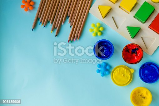 926151996istockphoto Office and student accessories on a pink. Back to school concept. School, education and learning concept. creativity for kids. Top view colorful background. Flat lay. 926139906