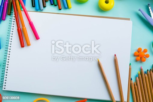926151996istockphoto Office and student accessories on a pink. Back to school concept. School, education and learning concept. creativity for kids. Top view colorful background. Flat lay. 926139928