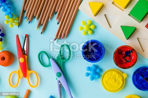 926151996istockphoto Office and student accessories on a pink. Back to school concept. School, education and learning concept. creativity for kids. Top view colorful background. Flat lay. 926140014