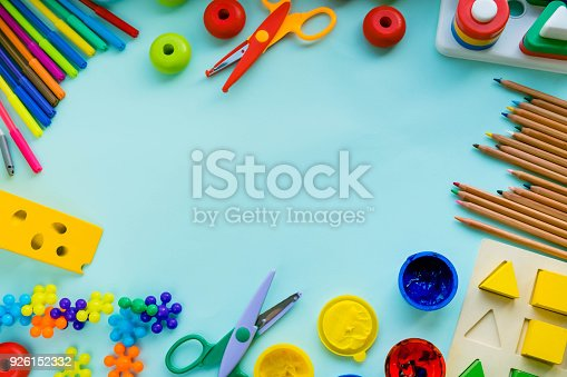 926151996istockphoto Office and student accessories on a pink. Back to school concept. School, education and learning concept. creativity for kids. Top view colorful background. Flat lay. 926152332