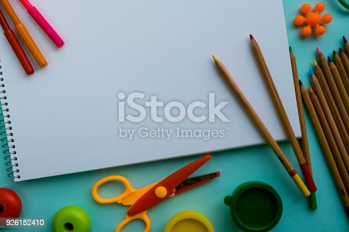 926151996istockphoto Office and student accessories on a pink. Back to school concept. School, education and learning concept. creativity for kids. Top view colorful background. Flat lay. 926152410