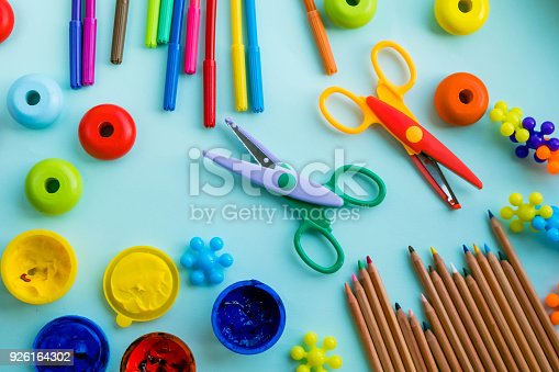 926151996istockphoto Office and student accessories on a pink. Back to school concept. School, education and learning concept. creativity for kids. Top view colorful background. Flat lay. 926164302