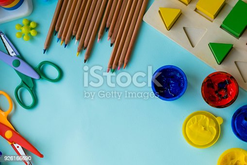 926151996istockphoto Office and student accessories on a pink. Back to school concept. School, education and learning concept. creativity for kids. Top view colorful background. Flat lay. 926166690