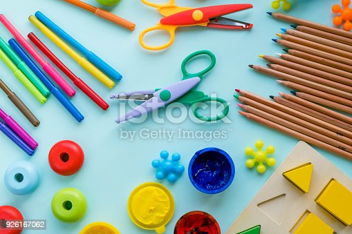 926151996istockphoto Office and student accessories on a pink. Back to school concept. School, education and learning concept. creativity for kids. Top view colorful background. Flat lay. 926167062