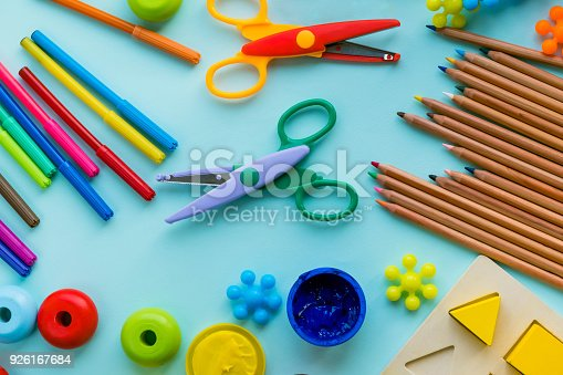926151996istockphoto Office and student accessories on a pink. Back to school concept. School, education and learning concept. creativity for kids. Top view colorful background. Flat lay. 926167684