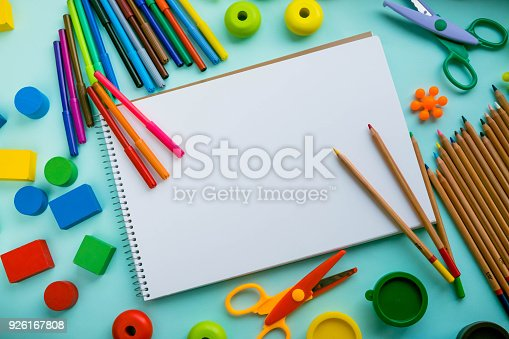 926151996istockphoto Office and student accessories on a pink. Back to school concept. School, education and learning concept. creativity for kids. Top view colorful background. Flat lay. 926167808