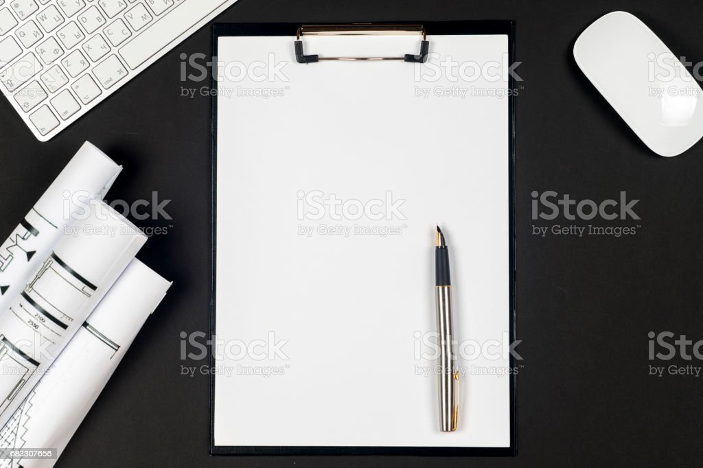 Office black desk table with white computer, supplies. zbiór zdjęć royalty-free