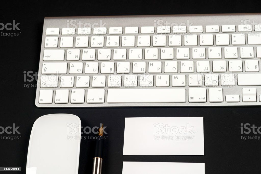 Office black desk table with white computer, supplies. foto stock royalty-free