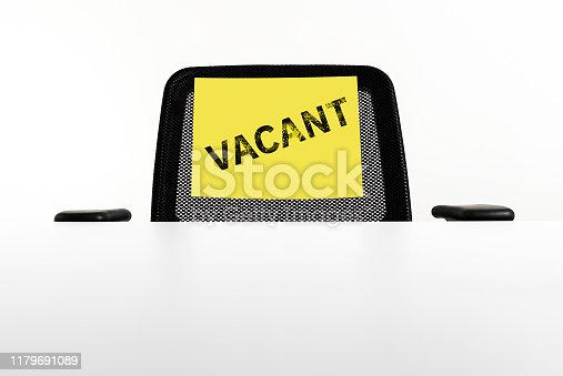 1153648747 istock photo Office black empty chair with yellow sign vacant. Business hiring, recruiting, job vacancy and job fired concept. 1179691089