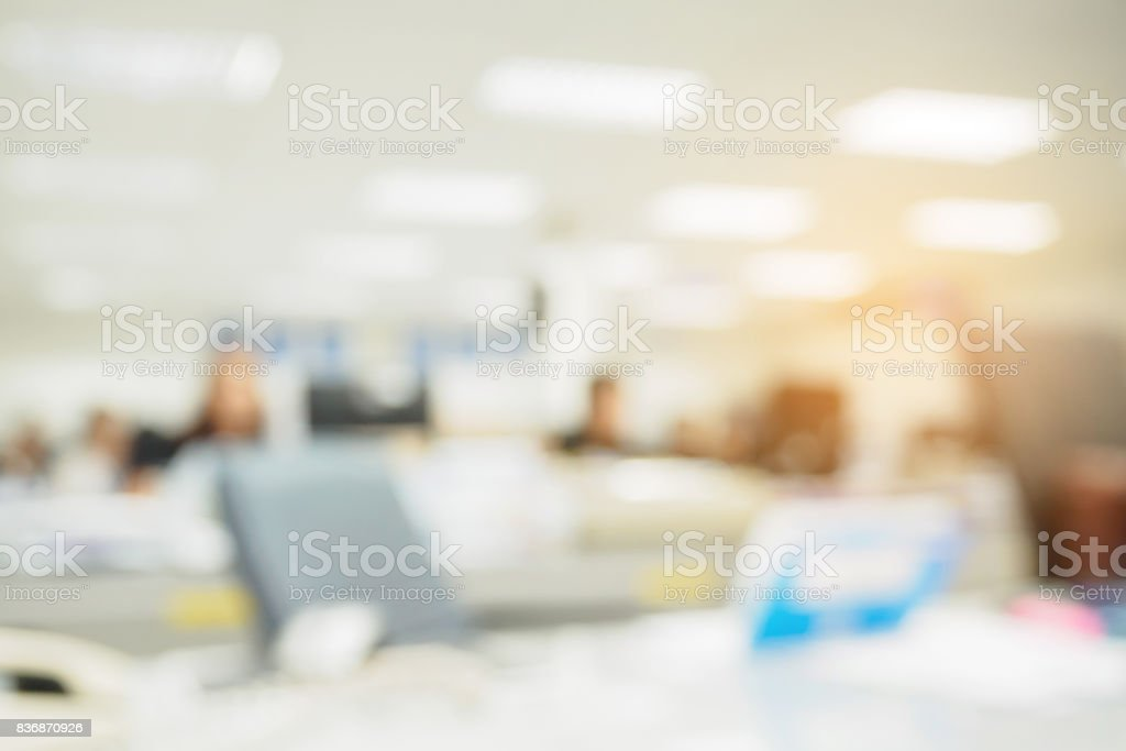 office blurred background with people working at desk stock photo