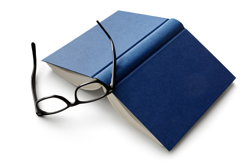 Office: Book and Reading Glasses Isolated on White Background