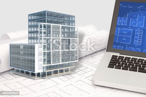 istock Office building architecture CAD project with blueprint and computer 463484923