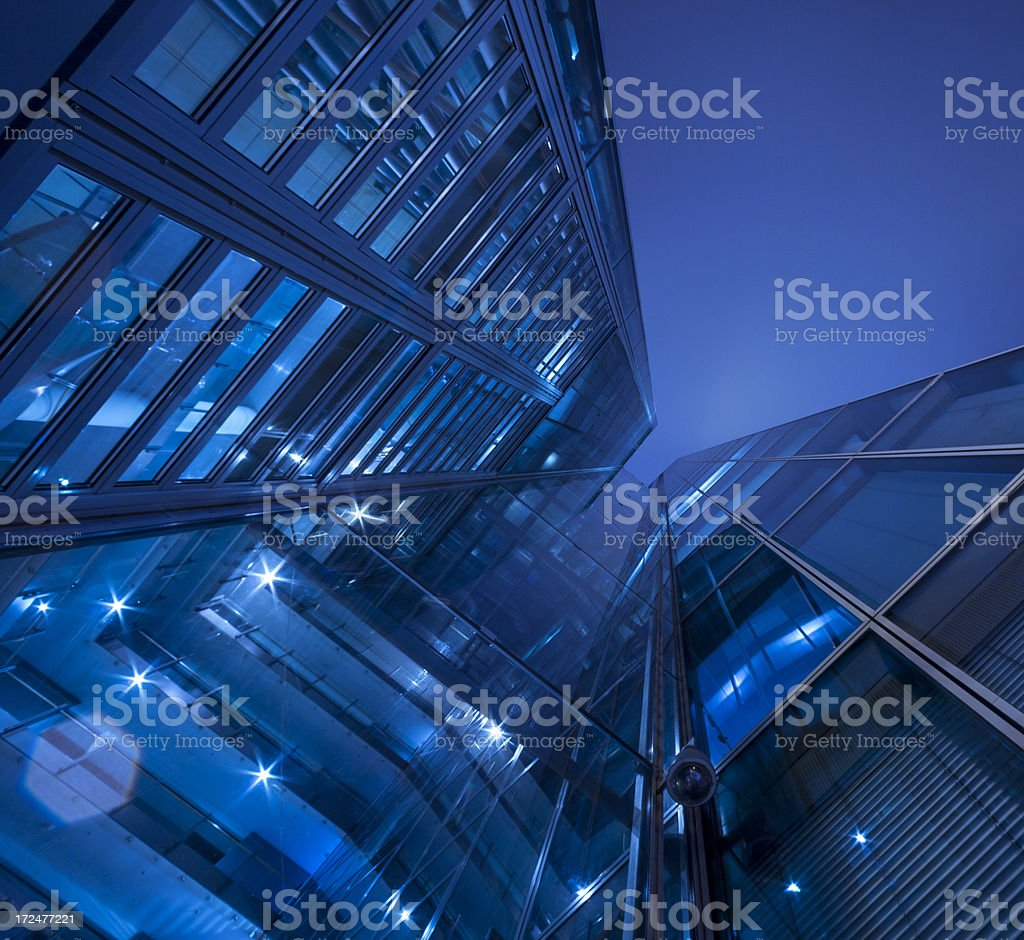 Office building at night, blue toned, Frankfurt, Germany stock photo