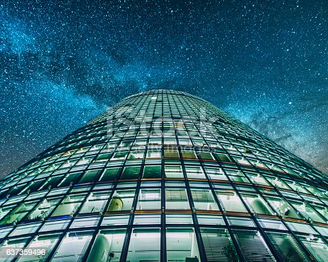 One of the main blocks of offices in Potsdamer Platz  square in Berlin, Germany, at night. The building is one of the main skyscrapers in Potsdamer Platz area, and contains offices from a handful of companies.