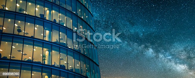 istock Office building at night 696698260