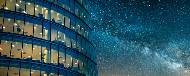 A beautiful office building at night. The building is part of a large group of office buildings situated near London's city hall building, United Kingdom.