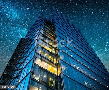 istock Office building at night 696701564