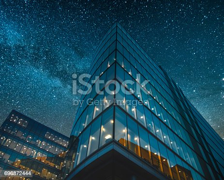 istock Office building at night 696872444