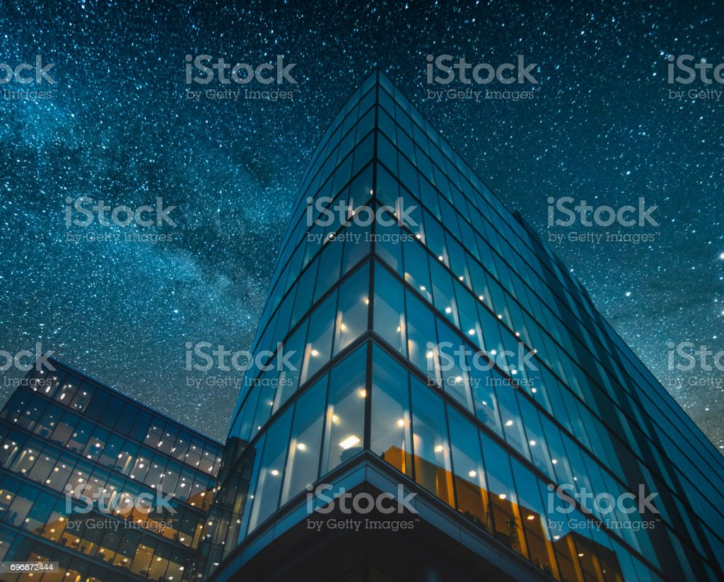 Office building at night stock photo