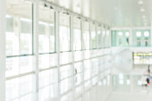 Office building blur background business lobby reception hall interior or empty indoor foyer meeting room with blurry light from glass wall window