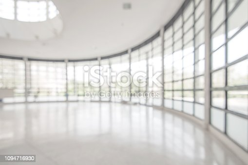 istock Office building business lobby blur background with blurry glass window transparent wall interior view inside empty entrance hall 1094716930