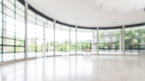 office building business lobby blur background with blurry glass window transparent wall interior view inside empty entrance hall - office background imagens e fotografias de stock