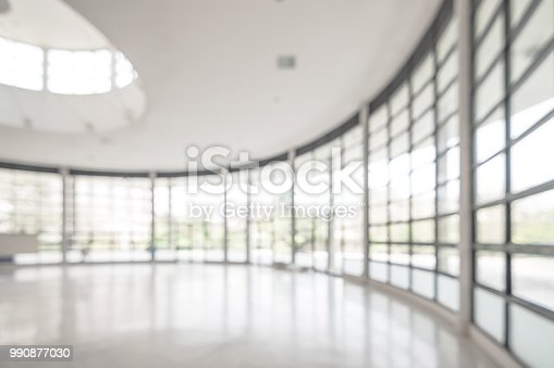 istock Office building business lobby blur background with blurry glass window transparent wall interior view inside empty entrance hall 990877030