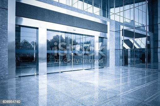 istock office building entrance and automatic glass door 626954740