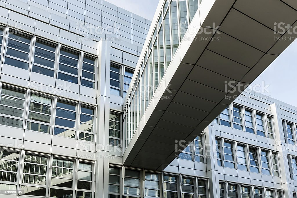 Office building facade and footbridge royalty-free stock photo