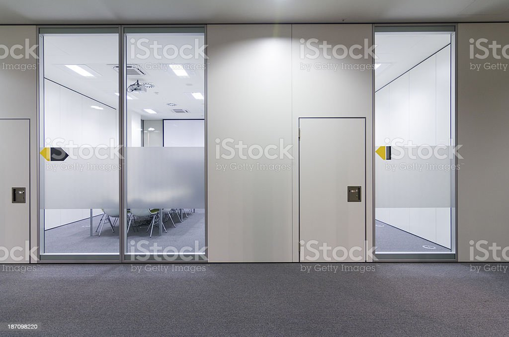 Office building hall and door leading into a conference room stock photo