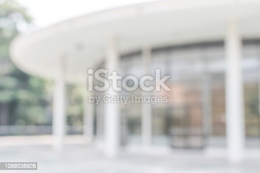990877026 istock photo Office building lobby or university entrance hall blur background with blurry exterior view of glass window and wall with light bokeh 1088538928