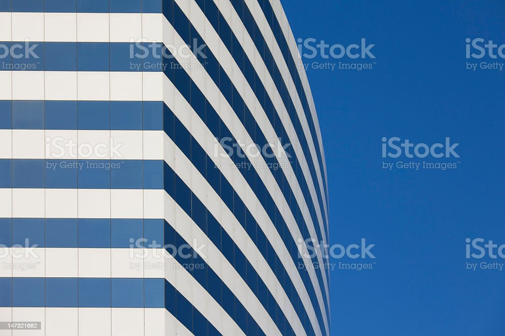 Office building with blue and white window stripes stock photo