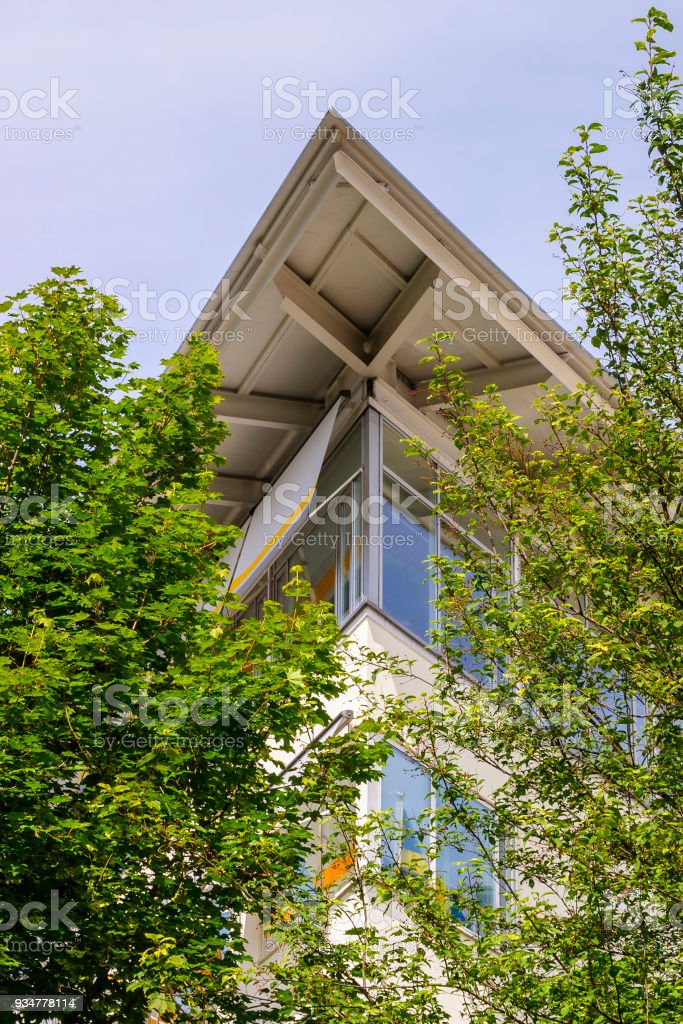 Office building with green trees stock photo