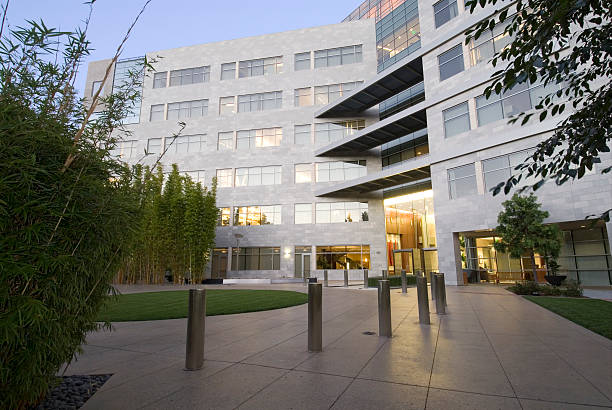 Office building with landscaping A modern office building with and attractive entrance. midsection stock pictures, royalty-free photos & images