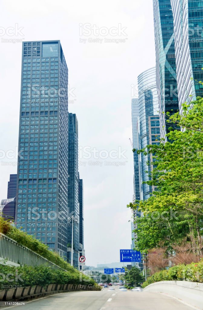 Office buildings and busy city street.