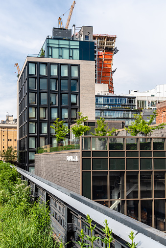New York City, USA - June 22, 2018: Office buildings and construction site in High Line. The High Line is an elevated linear park, greenway and rail trail.