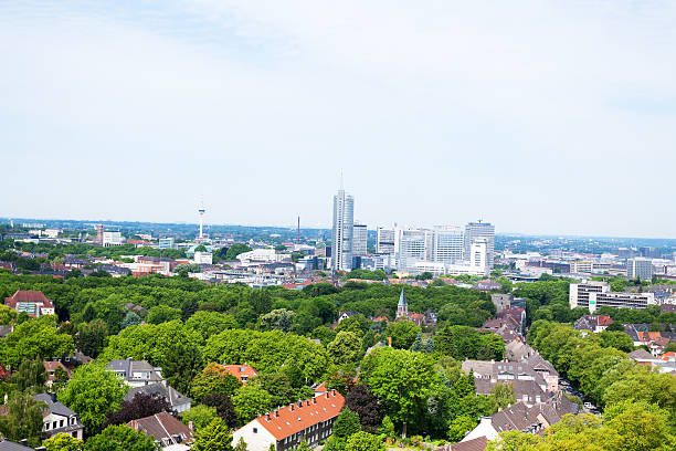 Office buildings and skyline of Essen Office buildings and skyline of Essen in spring. Non editorial aerial cityscape shot. north rhine westphalia stock pictures, royalty-free photos & images