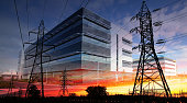 Photo montage of two electric pylons with a large industrial building in background