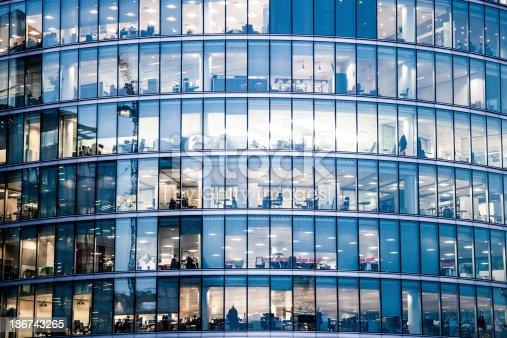 Office buildings in the night in London, UK.
