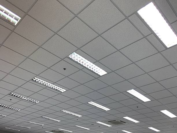 office ceiling - fluorescent light stock pictures, royalty-free photos & images