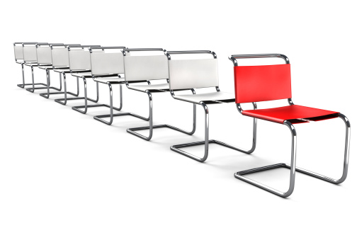 Modern Office Chairs in a line with the Red one Standing Out in the Front.The Office Chair Concept series: