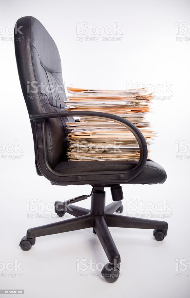 Office Chair Loaded with Paperwork royalty-free stock photo