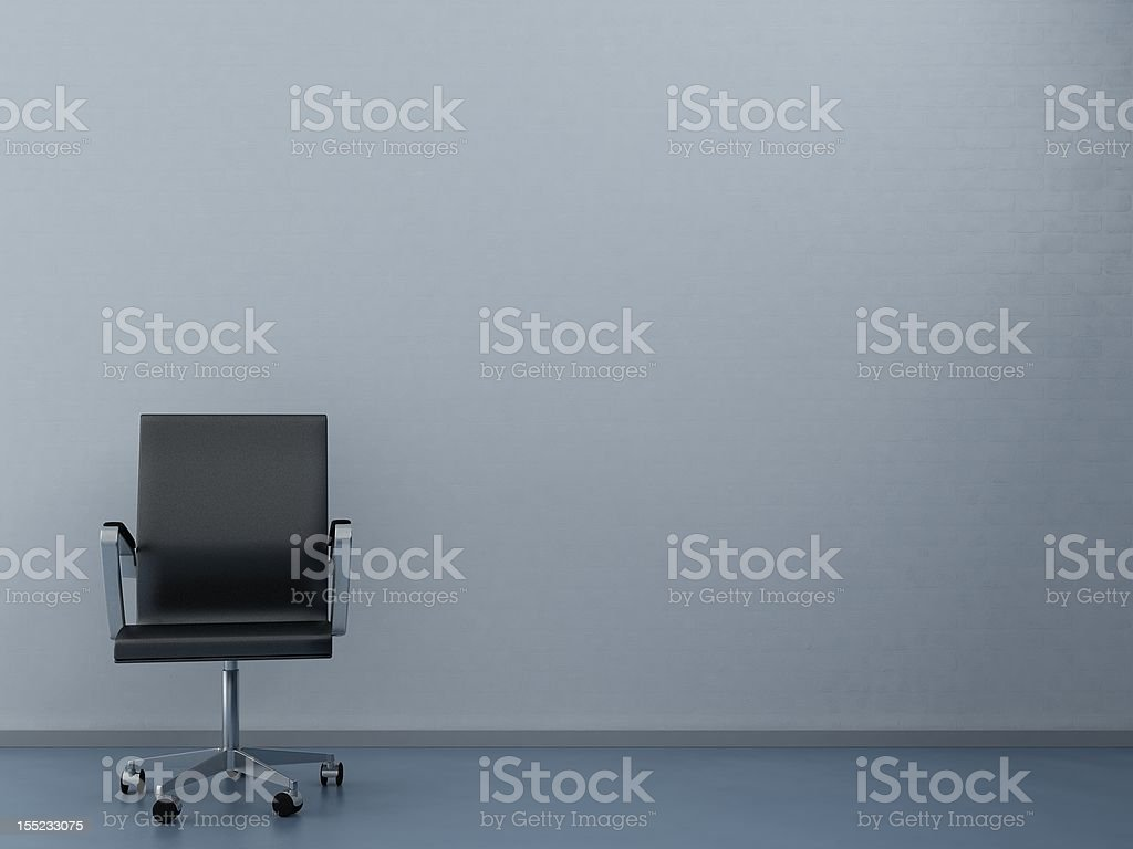 Office Chair to face a blank wall royalty-free stock photo